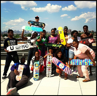 Hannah with Achievement First Brooklyn High School mentees building skateboards and life skills through STOKED.