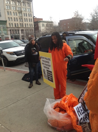 Jumpsuits, jumpsuits, jumpsuits! Creative protests outside courthouse at Scranton, PA.