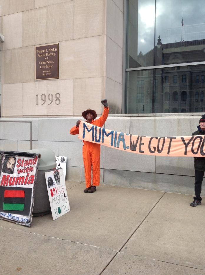 Mumia we got you! Outside courthouse at Scranton, PA